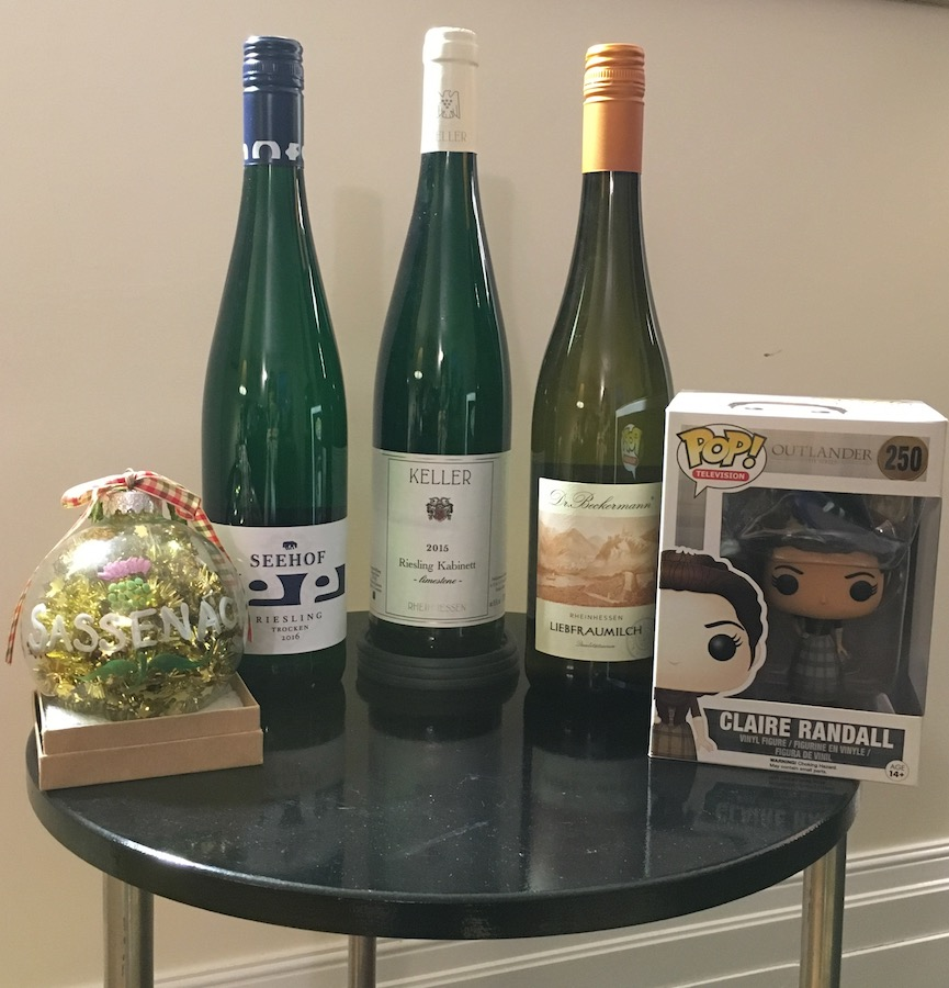Rhenish wine lineup in bottles with Outlander items