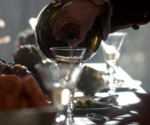 Rhenish wine being poured into glass in Outlander STARZ Season 1