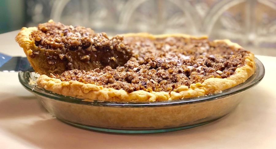 Praline Pumpkin Pie with lifted slice