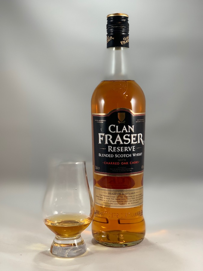 Clan Fraser Reserve in bottle with pour in glass