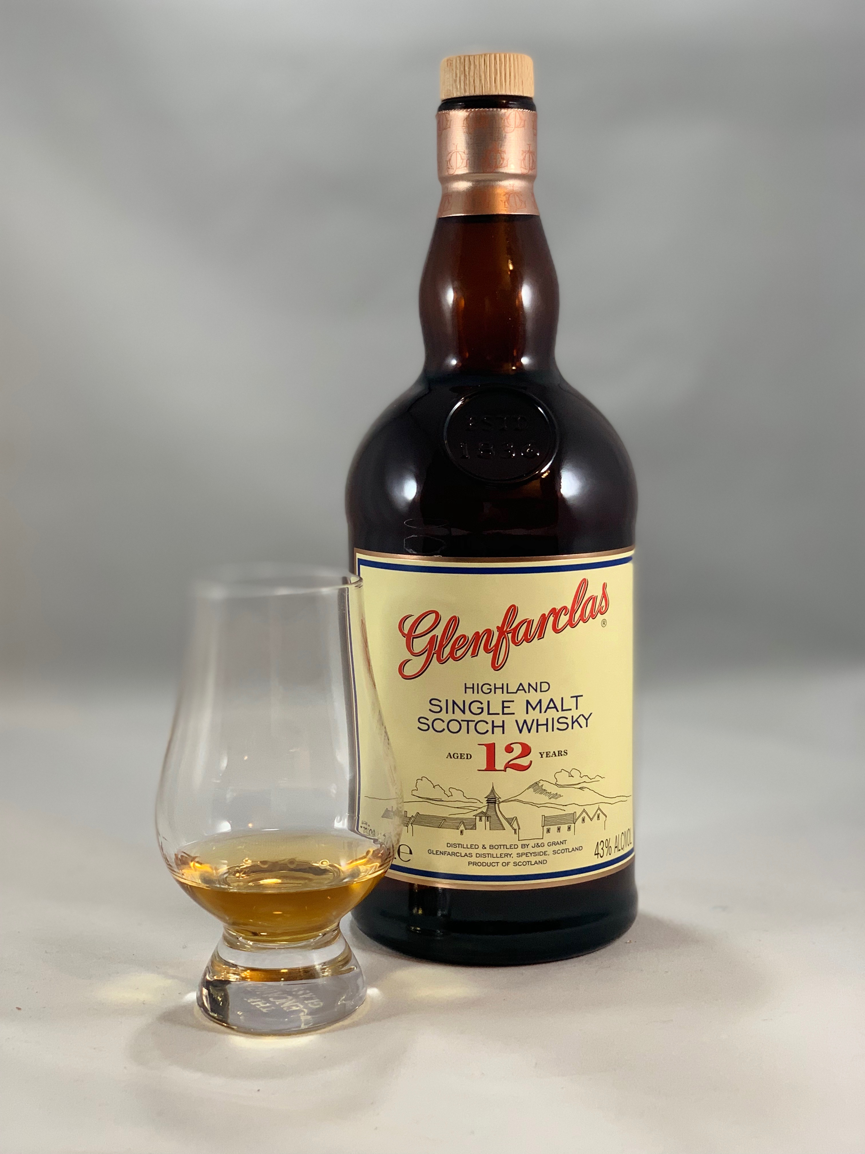 Glenfarclas 12yr in bottle with pour in glass