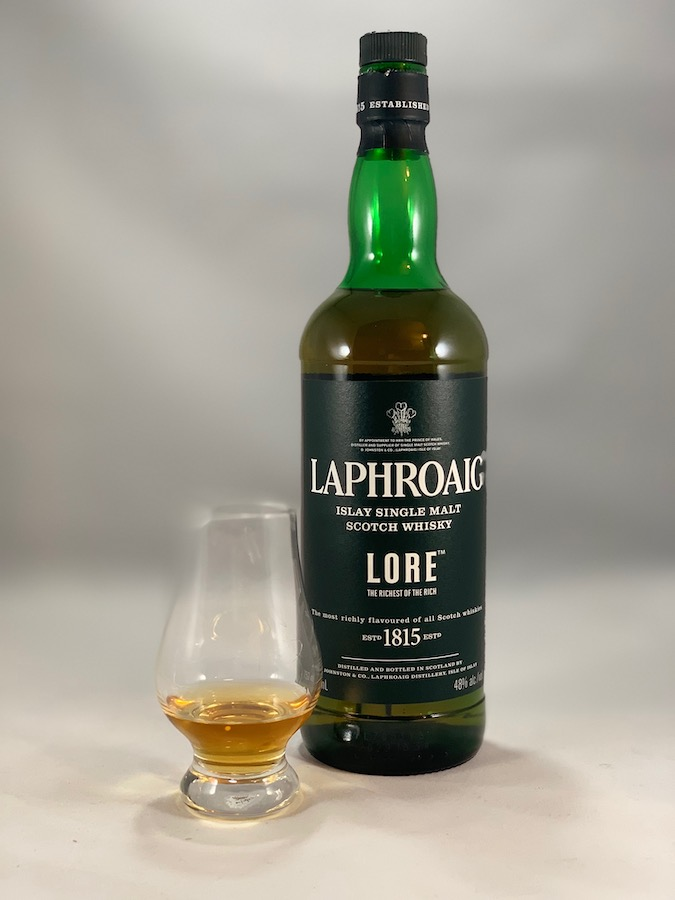 Laphroaig Lore in bottle with pour in glass