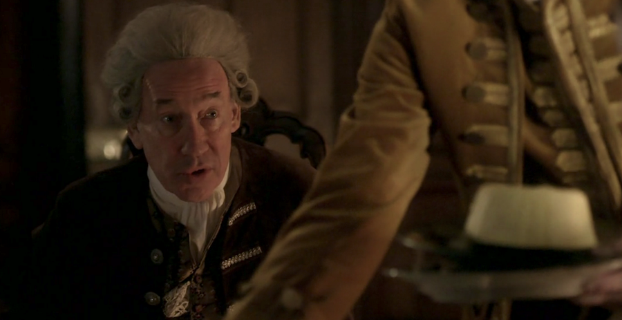 Simon Callow as the Duke of Sandringham close up with egg custard from Outlander STARZ Season 2