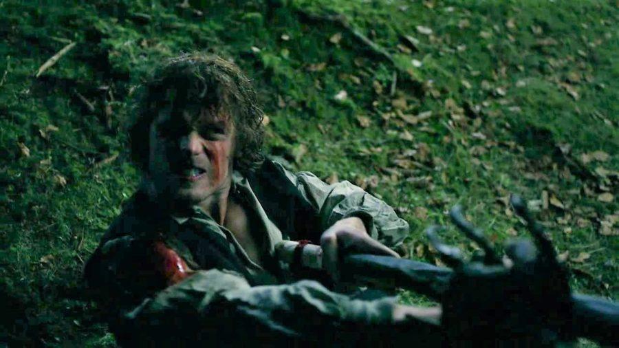 top 10 musical moments in outlander season 4, jamie fighting the bear in outlander