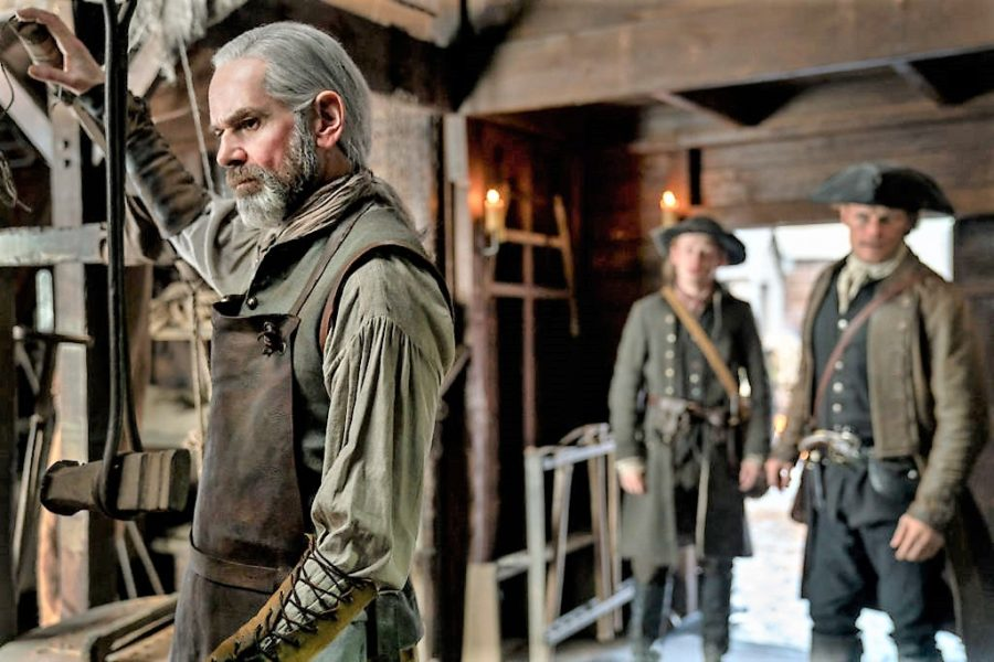 top 10 musical moments in outlander season 4, murtagh and jamie reunion in blacksmith shop