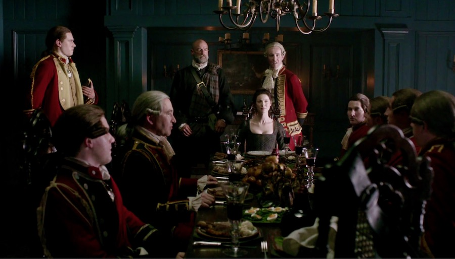 Claire, Dougal, Lord Thomas at the foot of the banquet table from Outlander STARZ Season 1, yorkshire pudding