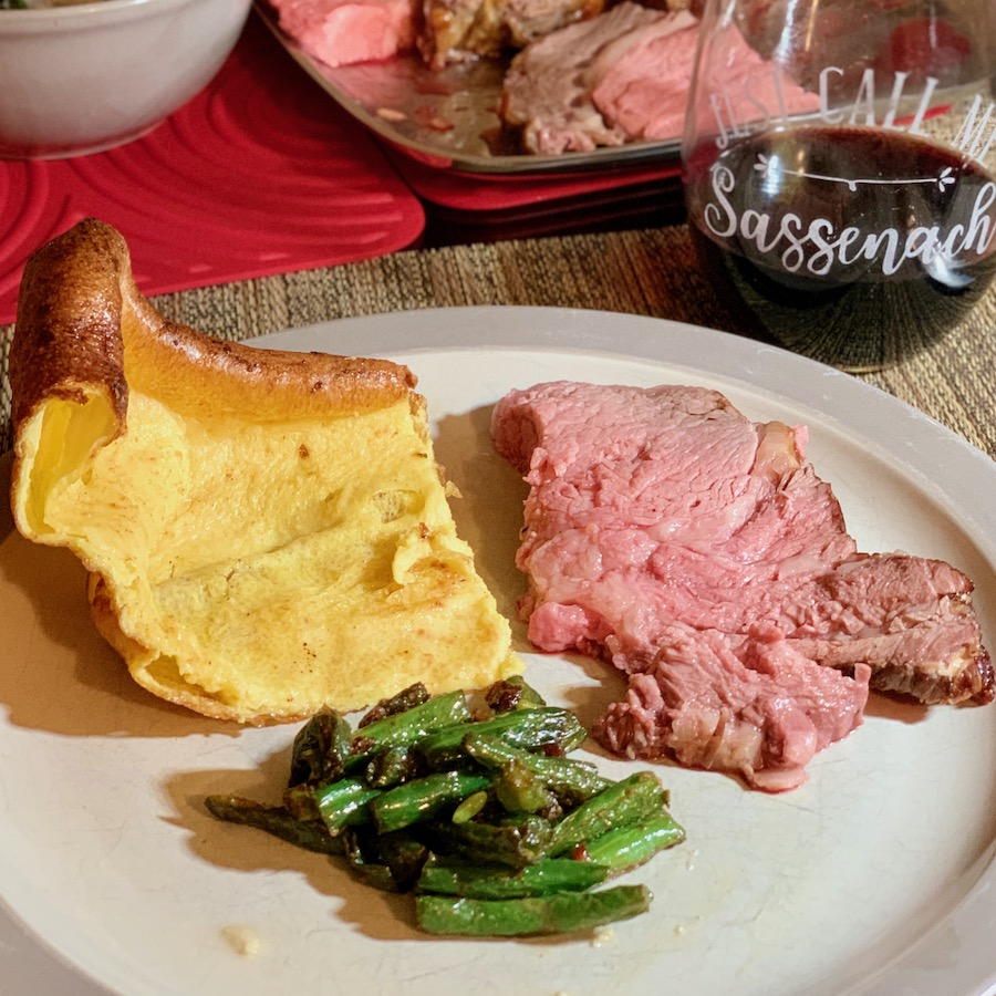 Yorkshire Pudding plated with roast beef and green beans