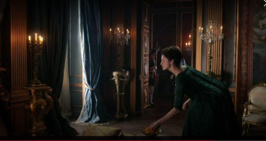 claire taking the orange in outlander season 2