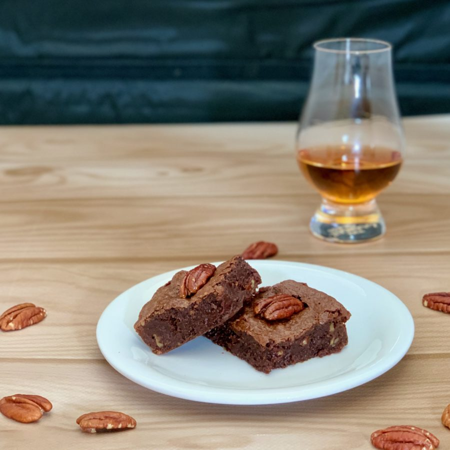 Candied Pecan Brownies plated with scotch glass closeup