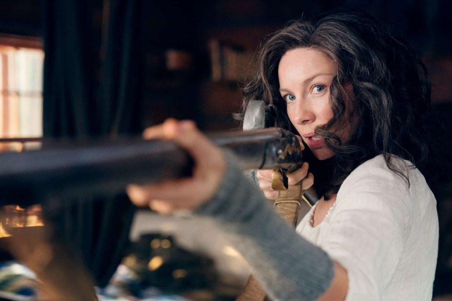 claire with gun in outlander season 5