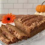 Sourdough Spice Cake sliced on plate with pumpkins closeup